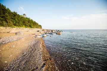 Stony seacoast of the Baltic sea at sunset. Hiumaa Island, Estonia