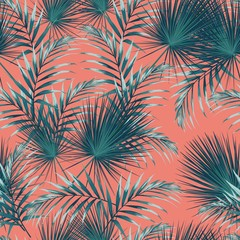 Seamless pattern with tropical leaves. Bright green palm leaves on the orange background.