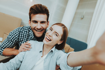 Young Couple Doing Selfie. New Apartment Concept.