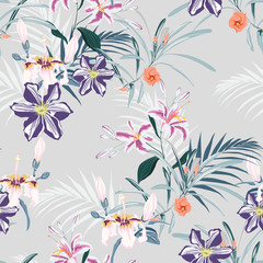 Seamless pattern, light vintage colors palm leaves and pink lilies, clematis and exotic tropical paradise flowers on vintage blue background.