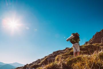 Little Boy backpacker traveler walk up on mountain top