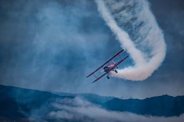 Biplane with Smoke