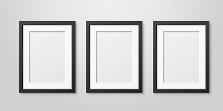 Three Vector Realistic Mofern Interior Black Blank Vertical A4 Wooden Poster Picture Frame Set Closeup on White Wall Mock-up. Empty Poster Frames Design Template for Mockup, Presentation