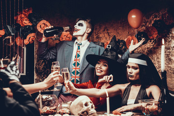 Wall Mural - Young People Wearing Costumes Drinking Champagne
