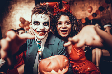 Wall Mural - Portrait of Young Couple in Halloween Costumes