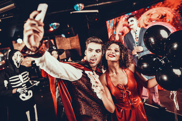 Wall Mural - Young People in Halloween Costumes taking Selfie