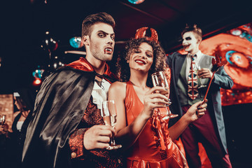 Wall Murals Music Band Young Happy Couple in Costumes at Halloween Party