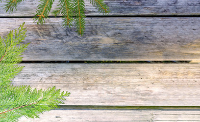 Distressed wooden table with evergreen branches