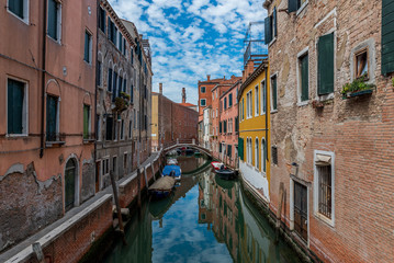 Typical street of Venice. Motorboats moored not far from the central water street without tourists, Italy
