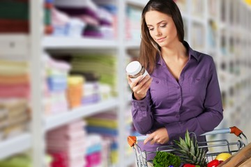 Young woman shopping in grocery store with