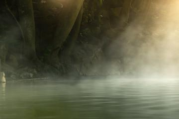 Morning is beautiful fog steam hot spring with sunlight at Hin Dat Hot Spring , Kanchanaburi , Thailand