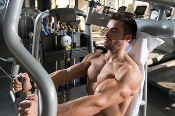 Bodybuilder Exercising Chest On Machine