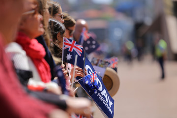 Crowds wait for the arrival of Britain's Prince Harry and Meghan, Duchess of Sussex, at the Sydney Opera House in central Sydney