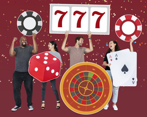 Happy diverse people holding casino icons