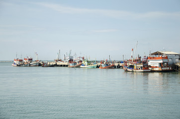 Fishing boat and ship floating in the sea for waiting fishing in night time at Ang Sila in Chonburi, Thailand