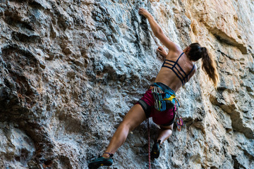 the girl climbs the rock
