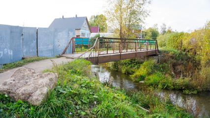small iron bridge across the river