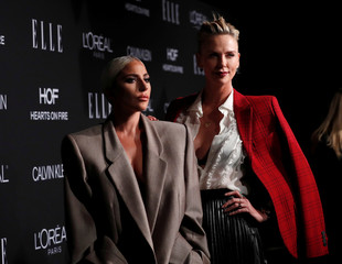 Honorees singer Lady Gaga and Charlize Theron pose at the 25th annual ELLE Women in Hollywood in Los Angeles