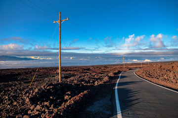 Road above clouds near Mauna Loa mountain, Hawaii