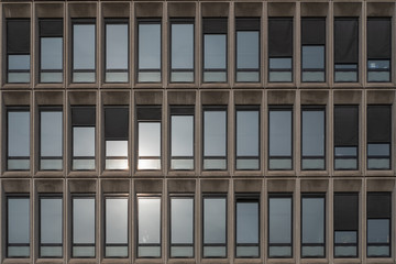 Grey glass and concrete office building facade