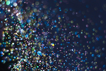 Abstract background with glittering color particles