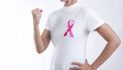Woman in white t-shirt with pink ribbon on chest. strong symbol of breast cancer awareness and international women day campaign.