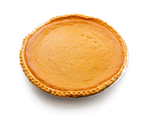 Fresh baked pumpkin pie isolated on white background