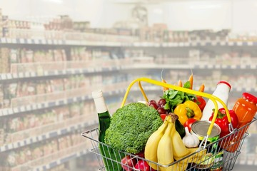 Shopping basket with variety of grocery products