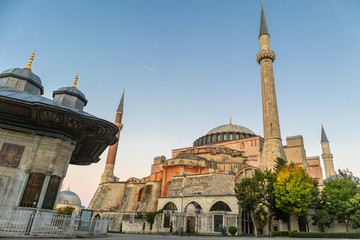 Hagia Sophia domes and minarets in Sultanahmed, old town of Istanbul, Turkey, at sunrise.
