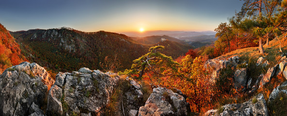 Mountain autumn landscape with colorful forest and Uhrovec castle, Slovakia