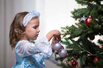 Little girl and Christmas fir