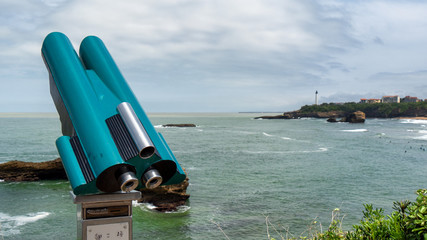 view of lighthouse on rocky coast of Biarritz, Basque, France