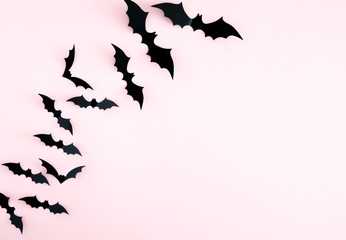 Halloween decorations concept. Halloween bats on pastel pink background. Flat lay, top view, copy space
