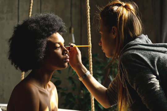 Professional make-up artist and African model