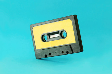 Retro cassette tape over blue background. top view. copy space.