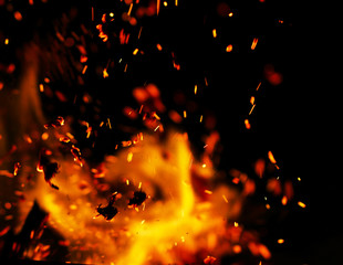 flame of fire with sparks black background