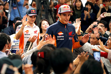 Repsol Honda Team's Marc Marquez and his teammate Dani Pedrosa attend a fan event in Tokyo