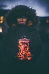 Boy with outdoors with christmas lights