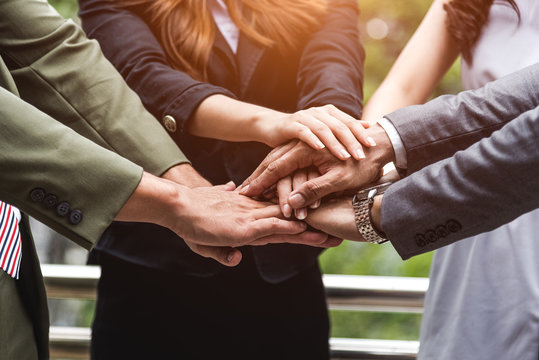 Close up of business people hands stacking as teamwork leadership assemble corporate in team company. Group of teamwork and cooperation as partnership and trust togetherness meeting collaboration.