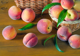 Ripe peaches on a wooden table.