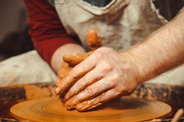Potter makes a jug
