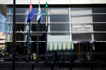 The national flags of Australia and Israel are seen outside the building housing the Australian Embassy in Tel Aviv