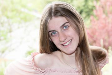 smiling blue eyes girl outdoor portrait