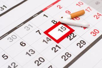 Calendar with a dedicated date where the broken cigarette