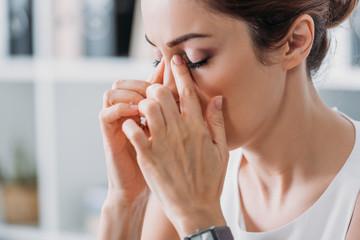 attractive tired businesswoman having headache