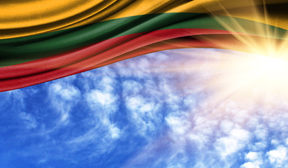 the flag of Lithuania in the rays sun