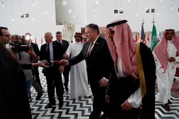 U.S. Secretary of State Mike Pompeo receives a gift during his visit to Riyadh