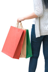 Shopping woman holding bags isolated on white background, consumerism, sale and people concept