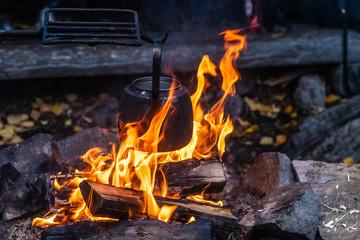 Black pot coffee made over campfire