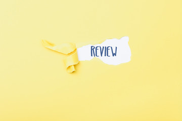Review word behind ripped piece of paper